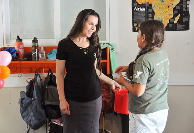 Gold Country YMCA director Aurora Packard assists a camper Friday at the Memorial Park headquarters.