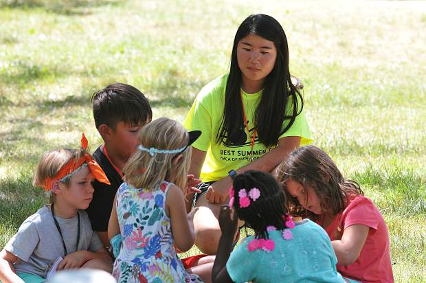 Counselor in training Mei Douros, plays with a group of kids during Friday's YMCA camp at Memorial Park in Grass Valley.