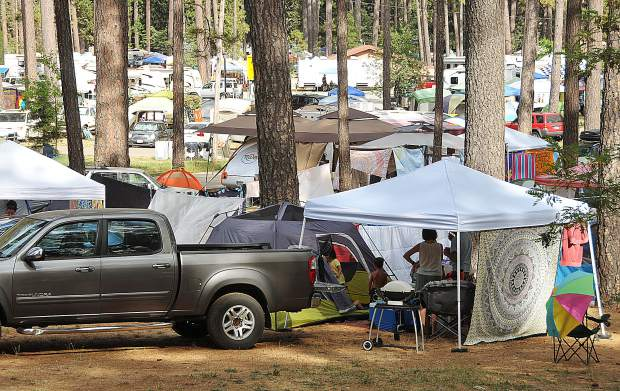 A tent city pops up overnight at the Nevada County Fairgrounds for California WorldFest, which ended its four-day run Sunday. The annual festival is a large tourism and economy driver for Grass Valley.