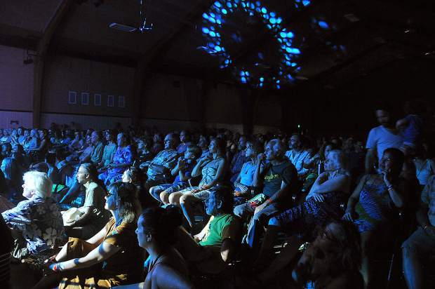 Folks watch sitarist Anoushka Shankar's set while a light show fills the pavilion during California WorldFest last week in Grass Valley