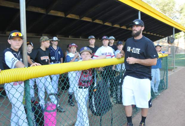 Justin Deme, head of baseball operations for Sierra Nevada Elite Baseball Academy, leads a free youth baseball camp earlier this week at Nevada Union High School.