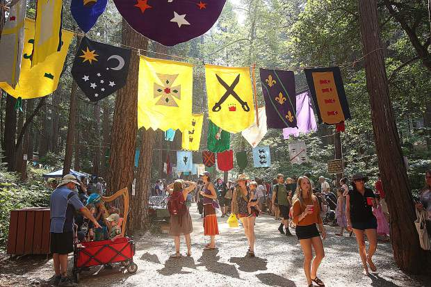 Hundreds of Children's Festival goers fill the picnic area of Pioneer Park, which was transformed to resemble medieval times and offered different crafts for the kids and kids at heart, to make.