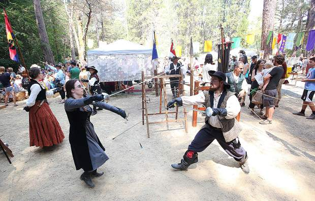 A pair of Diamond Rose Fencers hone their sword swinging skills during Friday's Childrens Festival.