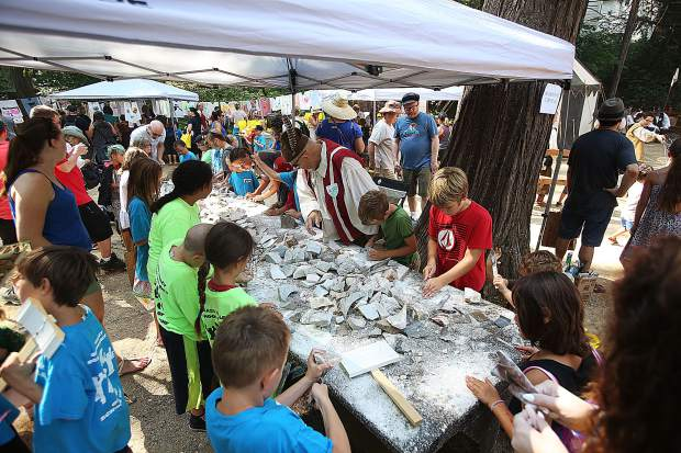 Many different crafts were available for the youth of the Children's Festival to make, including wooden swords, shields, stone tablets, necklaces, and much more.