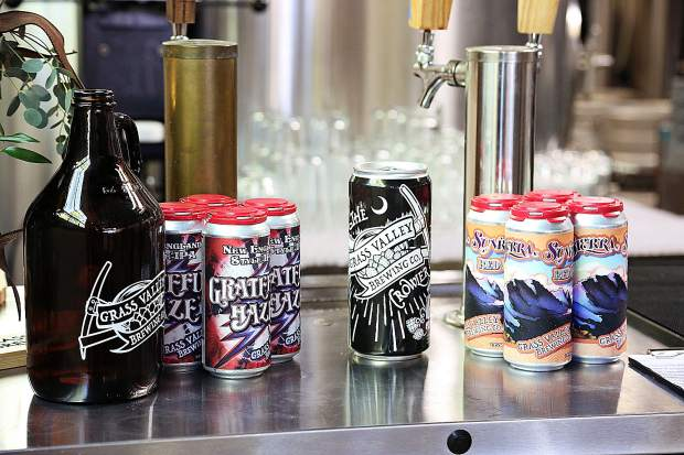 Some of the brewing company's canned beers along with their to-go growlers sit on display at Grass Valley Brewing Company in downtown Grass Valley.