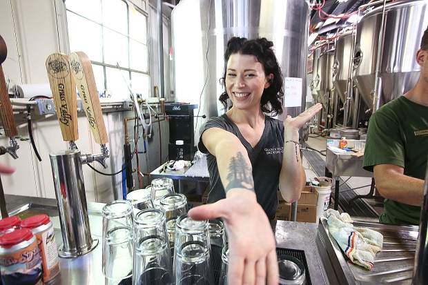 Grass Valley Brewing's tap room manager Mimi King is ready to serve beer from the tap room portion of the business, slated to open in the next few weeks.