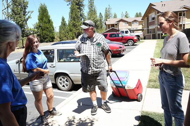 Food Bank of Nevada County volunteers are ready to distribute lunches from their free Summer Lunch Program, to Nevada County youth last week in the Glenbrook Basin.