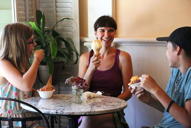 Mayela (from left), Heidi and Anarion Woods beat the heat and get out of the sun Tuesday afternoon while enjoying some of their favorite ice cream scoops inside Treats of Nevada City.