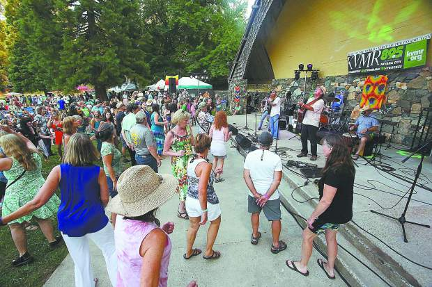 Nevada City's own Achilles Wheel rock and roll band, takes to the band shell at Pioneer Park Saturday evening, where hundreds of folks gathered to celebrate KVMR's 40th anniversary with an all day party featuring music, food, and libations.