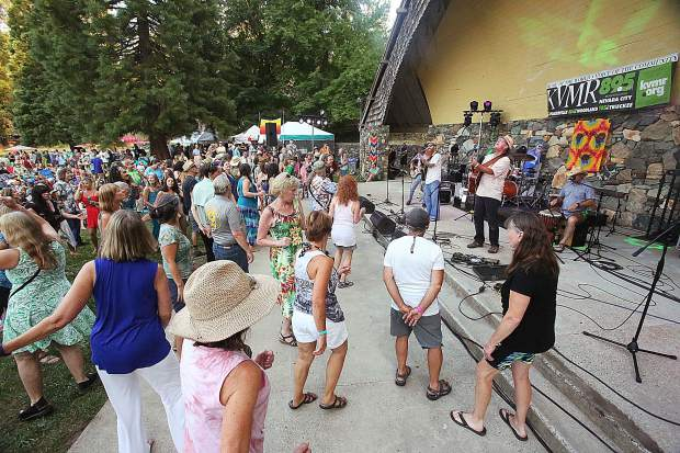Nevada City's own Achilles Wheel rock and roll band takes to the band shell at Pioneer Park Saturday evening, where hundreds of folks gathered to celebrate KVMR's 40th anniversary with an all day party featuring music, food and libations.