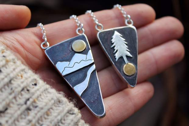 Leora Coronel, owner of Gather Jewelry, displays two of her pieces inspired by the Sierra Nevada. Learn more at GatherJewelry.com