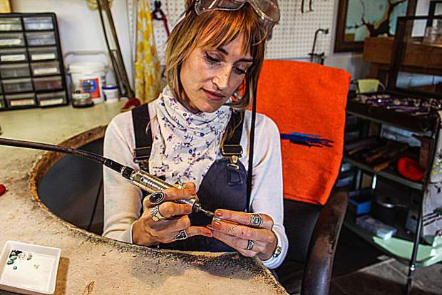 Leora Coronel, owner of Gather Jewelry, works on a custom piece in her home studio in Nevada City. Learn more at GatherJewelry.com.