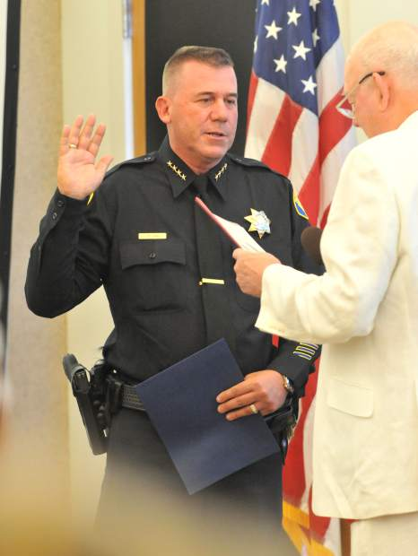 Interim Nevada City Police Chief James Leal is sworn in by Nevada City Clerk Niel Locke at the beginning of Wednesday night's city council meeting. Leal is taking over for Chief Tim Foley who stepped down in February.