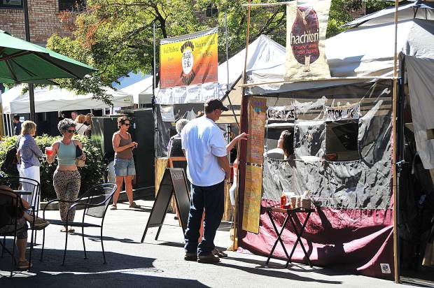 Hot food is offered by vendors as well as the fresh fruits, vegetables, meat and breads available during the Nevada City Farmers Market Saturday morning.