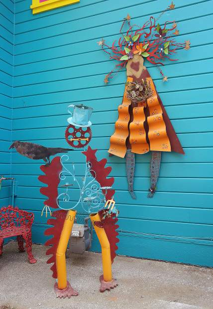 Sheriff Itchy Trigger Fingers and Summer, metal art pieces by Ginny Davis, are just some of the many creations that surround the Boulder Street home in Nevada City.