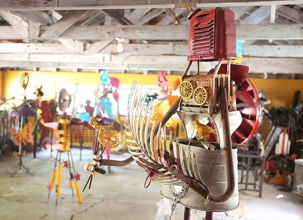 One of Ginny Davis' many metal sculptures stands alongside others in her shop and gallery space.