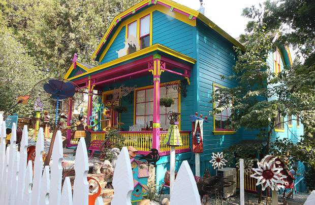 Ginny Davis' Boulder Street home isn't your typically decorated Nevada City Victorian. Aside from being painted in a style resembling a New Orleans row house, the yard is rife with the whimsical metal sculptures of Davis' creations.