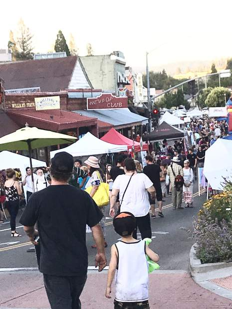 Attendees walking in downtown Grass Valley during the first Thursday Night Market.