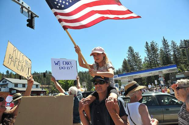 A young patriot and her father proudly display the United States flag during Saturday morning's rally.