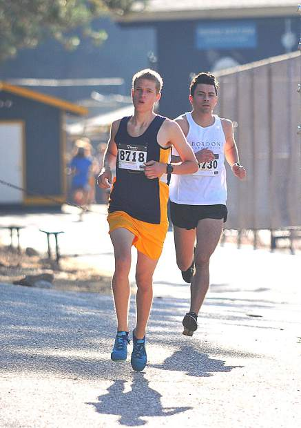 Garrett Gough, front, and Jack Bordoni took the top two places in the men's race at the Freedom Run 5K, Wednesday at Nevada Union High School. Gough placed first with a time of 16 minutes, 20 seconds.