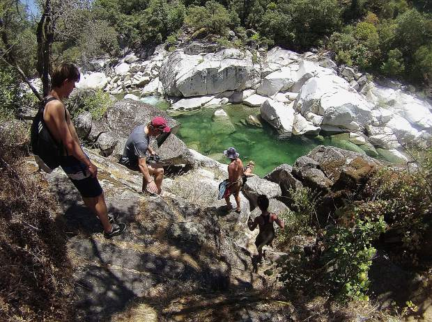 A group of river safety ambassadors descend from Hoyt's Trail during an impromptu river safety training day on the South Yuba River near the Highway 49 bridge Thursday.