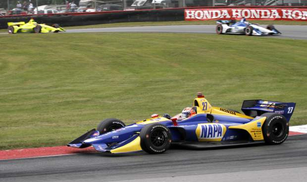 Using a two-stop fuel strategy, Alexander Rossi led 66 of the 90 laps and won the IndyCar Series auto race at Mid-Ohio Sports Car Course in Lexington, Ohio Sunday.