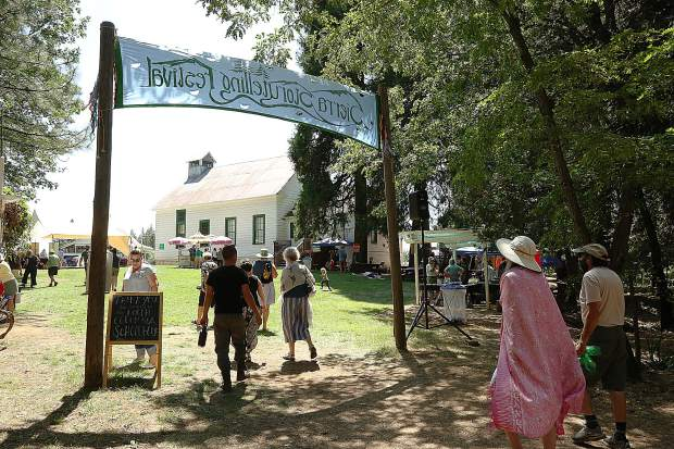The grounds of the North Columbia Schoolhouse, and the adjacent outdoor amphitheater, are the celebrated home of the Sierra Storytelling Festival. Festival goers spent time between the amphitheater and the grassy area where food and craft vendors offered their services.
