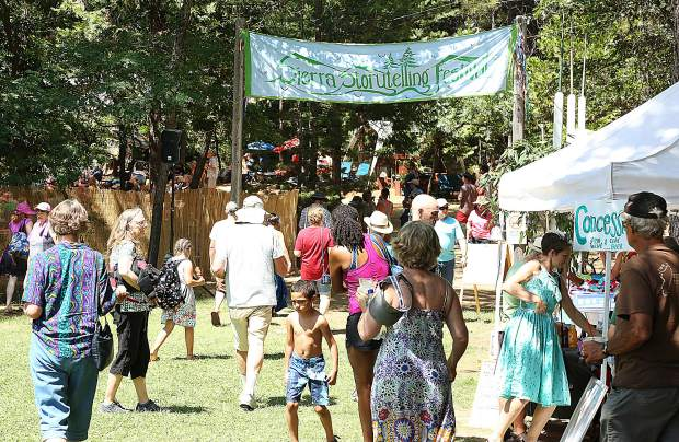 Hundreds of folks walk the grounds of the 33rd Sierra Storytelling Festival at the North Columbia schoolhouse.
