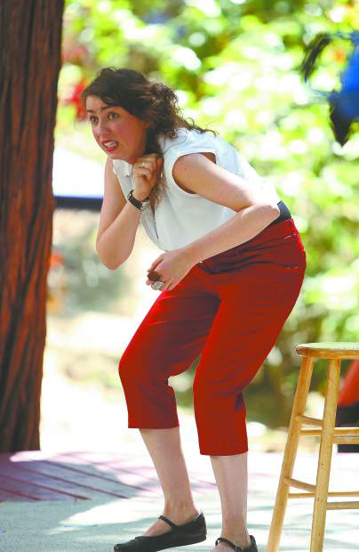 Muireann Murphy imitates a hunchback during one of her performances on stage during the 33rd installation of the Sierra Storytelling Festival.