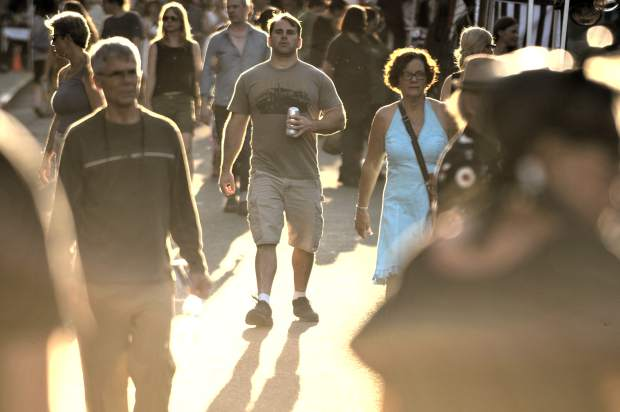 Folks walk down Broad Street, some with open alcoholic containers, during Wednesday's Summer Nights event in downtown Nevada City. The ability to consume alcoholic beverages during the Nevada City event has been an added draw for Summer Nights visitors.