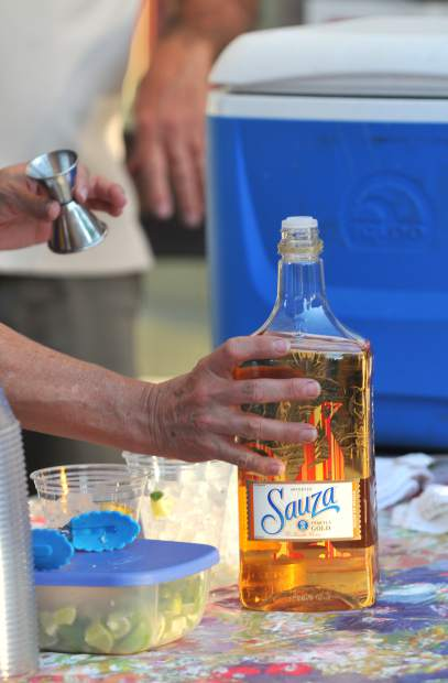 Members of the Nevada City Chamber of Commerce prepare mixed drinks for Summer Night's patrons during the initial event of the summer Wednesday along Broad Street.