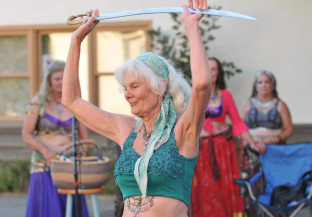 Troupe Al Ama belly dancers provide entertainment set to music near the intersection of Pine and Spring Streets during Wednesday's Summer Nights event in downtown Nevada City.