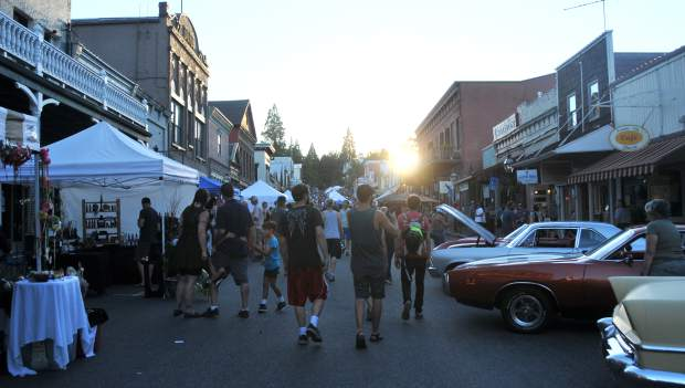 Folks walk the downtown streets of Nevada City for the 28th annual Summer Nights event.