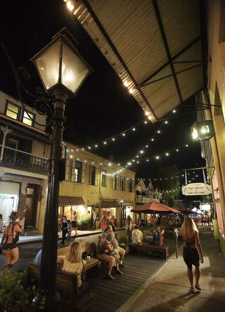 Summer Nights attendees enjoy a stroll along Commercial Street in downtown Nevada City, a portion of roadway that the city is considering closing to automobile traffic permanently.
