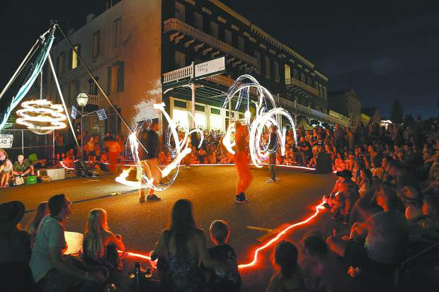 The Sol Risers fire dance troupe captivates the crowds of Wednesday's Summer Nights event in downtown Nevada City.