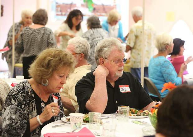 Attendees of the Sierra Roots tiny home fundraiser enjoy their meal.