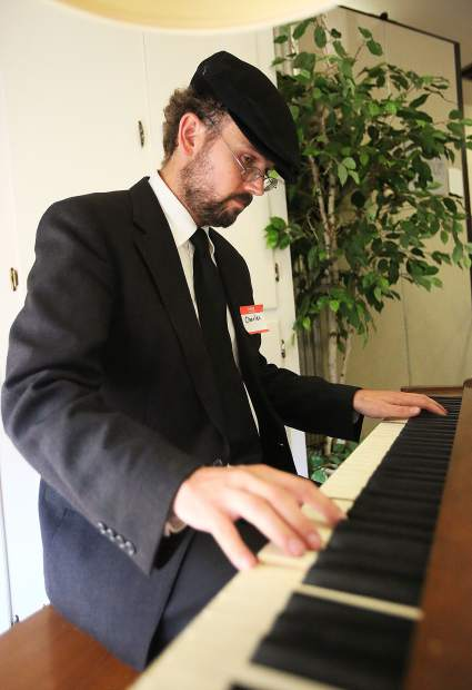 Charles Lang plays the piano to add to the ambiance of the Dare to Dream fundraiser Saturday at Nevada City's First Baptist Church. Lang is also a client of Sierra Roots who currently lives in a vehicle and would be one of those to benefit from a tiny home community.