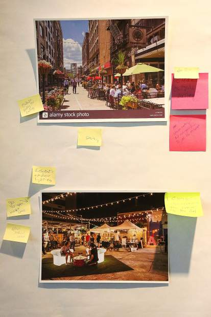 Photos of different types of open public spaces filled the walls of Nevada City Hall, where attendees of Tuesday's open spaces town hall meeting could comment on them.