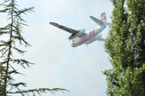 Cal Fire air tanker 88 readies to drop a load of fire retardant in the Dove Road area of western Nevada County where a 4-6 acre vegetation fire burned Wednesday afternoon.