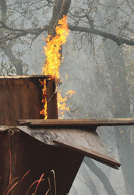 An outbuilding along Dove Road burned from the spreading vegetation fire.
