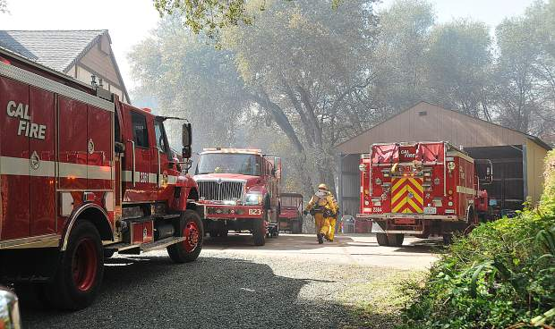 Cal Fire and other local fire agencies protected homes along Dove Road during Wednesday's vegetation fire. The cause of the fire was not determined as of press time.