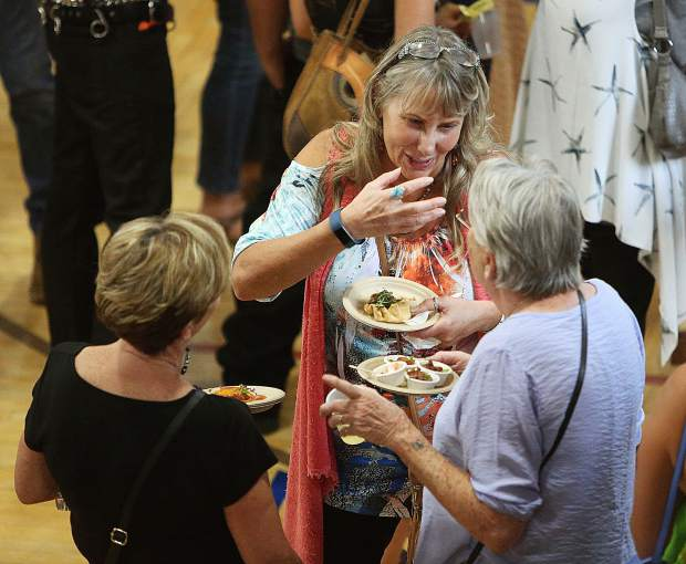 Longtime friends Melissa Adams, (from left) Donna Raibley, and Michelle Carrol enjoy a conversation over their Bounty of the County treats.