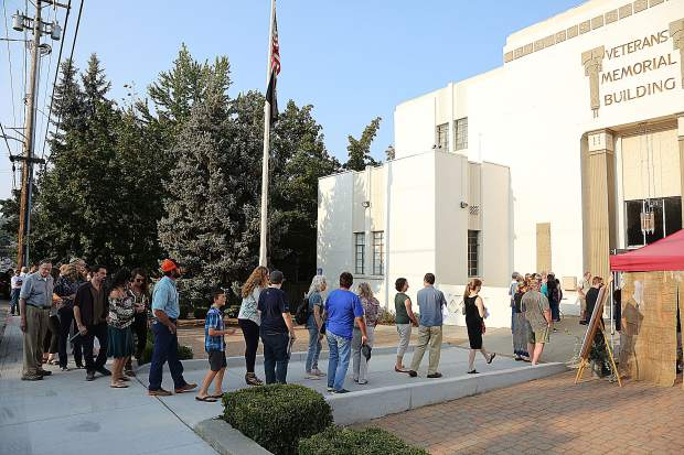 Folks line up outside of the Veteran's Memorial Hall in Grass Valley for the Bounty of the County event.