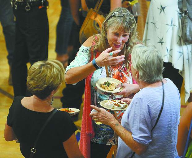 Longtime local friends Melissa Adams (from left) Donna Raibley, and Michelle Carrol enjoy a conversation over their Bounty of the County treats.