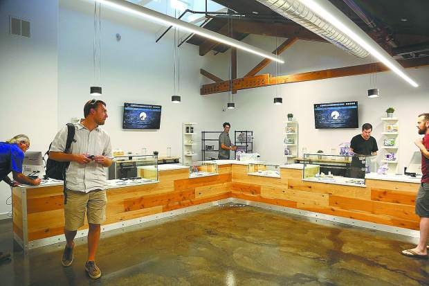 Workers at Elevation 2477 put the finishing touches on Nevada County's first medicinal cannabis dispensary Monday afternoon at 569 Searls Avenue in Nevada City.