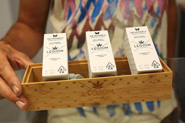 An Elevation 2477' employee shows off some of the cannabis products that will be available for purchase beginning Thursday at Nevada County's first cannabis dispensary at 569 Searls Avenue in Nevada City.