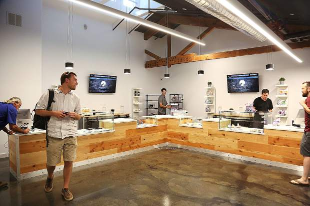 Workers at Elevation 2477' put the finishing touches on Nevada County's first medicinal cannabis dispensary Monday afternoon at 569 Searls Avenue in Nevada City.