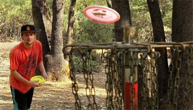 Zachary Bianchi practiced his short game, throwing the disc into a basket Saturday at Condon Park in Grass Valley. Saturday was National Disc Golf Day, the first Saturday in August, and the event held at Condon Park included raffles, disc golf games and a barbecue at the park.