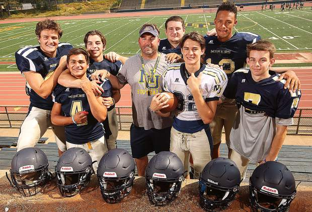 Nevada Union's new head coach Brad Sparks has brought a new energy to the program and his players are buying in. From left: Matthew Dal Bon, Duke Morales, Hayden Lee, Brad Sparks, Dylan Hart, Parker Heilaman, Cameron Dallago and A.J. Meyer.
