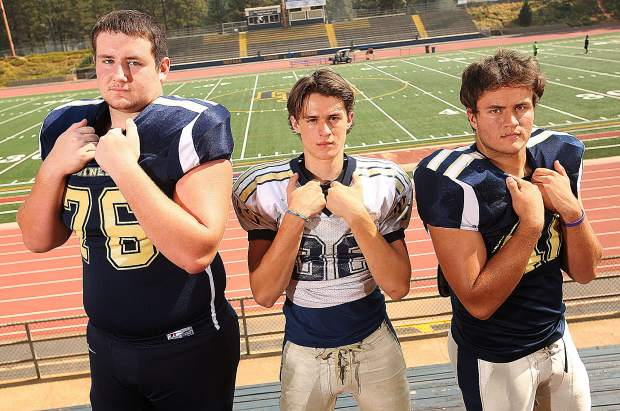 Offensive linemen Dylan Hart, left, and Matthew Dal Bon, right, will be tasked with protecting quarterback Parker Heilaman, center, this season.